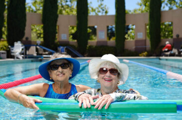two woman smiling in pool