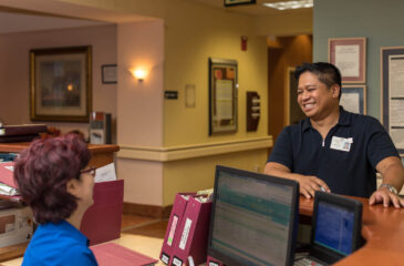 employee smiling at coworker
