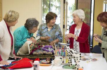 women socializing at craft group
