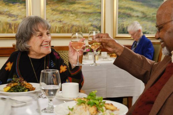 Couple raising wine glasses in toast