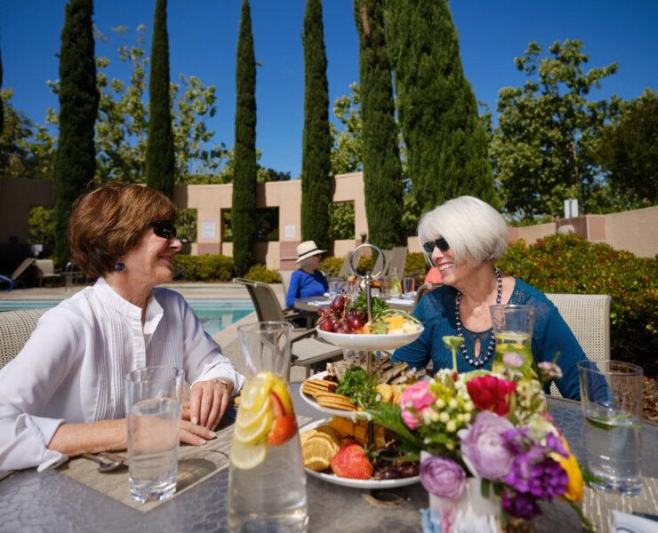 Women enjoying a snack outside