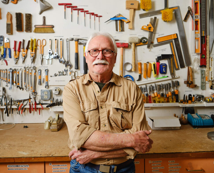 man standing in front of workshop bench