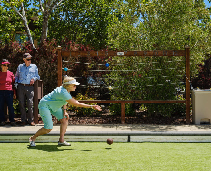 Woman tossing bocce ball
