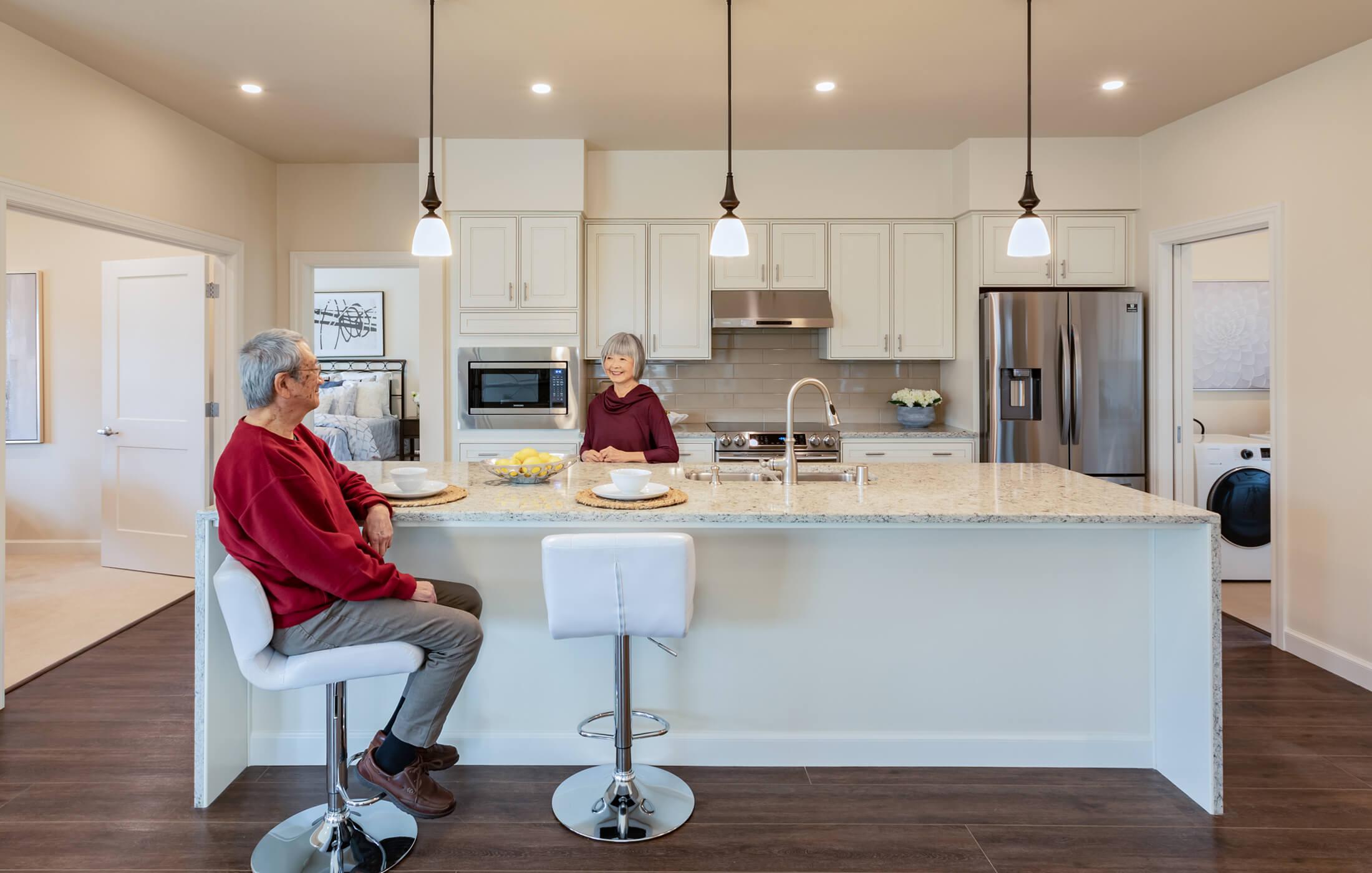 Couple enjoying their kitchen